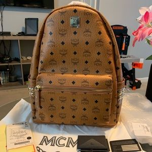 Mcm backpack with studs